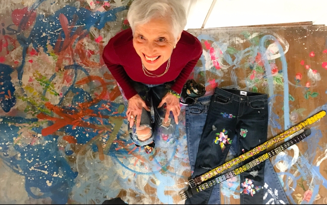 Carol with her artwork clothing